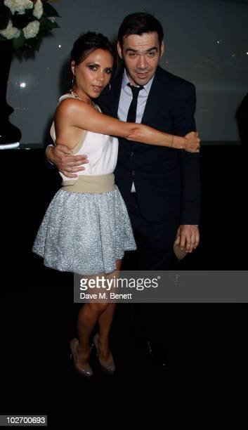 Victoria Beckham and Roland Mouret attend the Net A Porter 10th Anniversary Housewarming Party at Westfield Shopping Centre on July 7 2010 in...