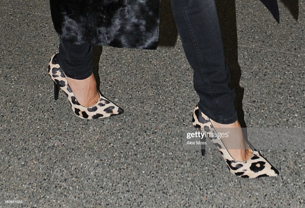 Victoria Beckham (shoe detail) arrives back in London from Paris on February 25, 2013 in London, England.