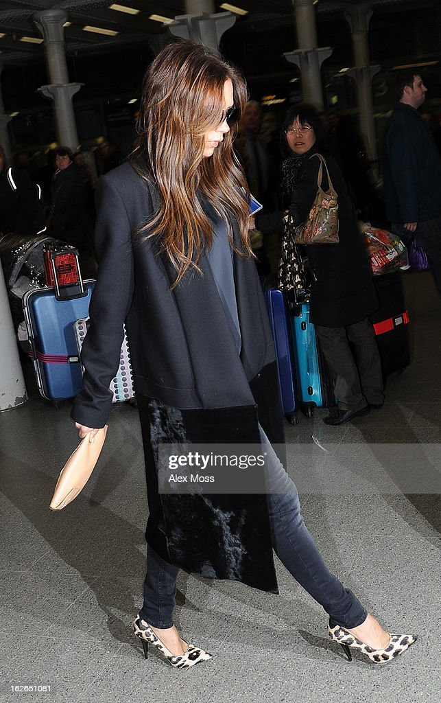 <a gi-track='captionPersonalityLinkClicked' href=/galleries/search?phrase=Victoria+Beckham&family=editorial&specificpeople=161100 ng-click='$event.stopPropagation()'>Victoria Beckham</a> arrives back in London from Paris on February 25, 2013 in London, England.