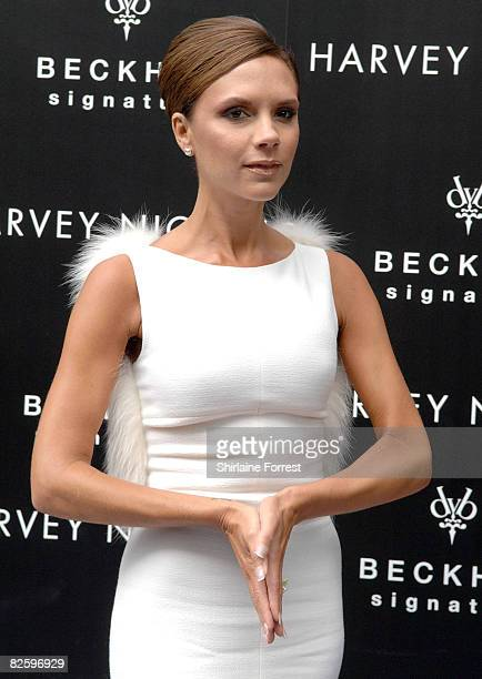 Victoria Beckham attends a photocall for the launch of hers' and her husband David Beckham's new fragrance entitled 'Signature For Him and Signature...