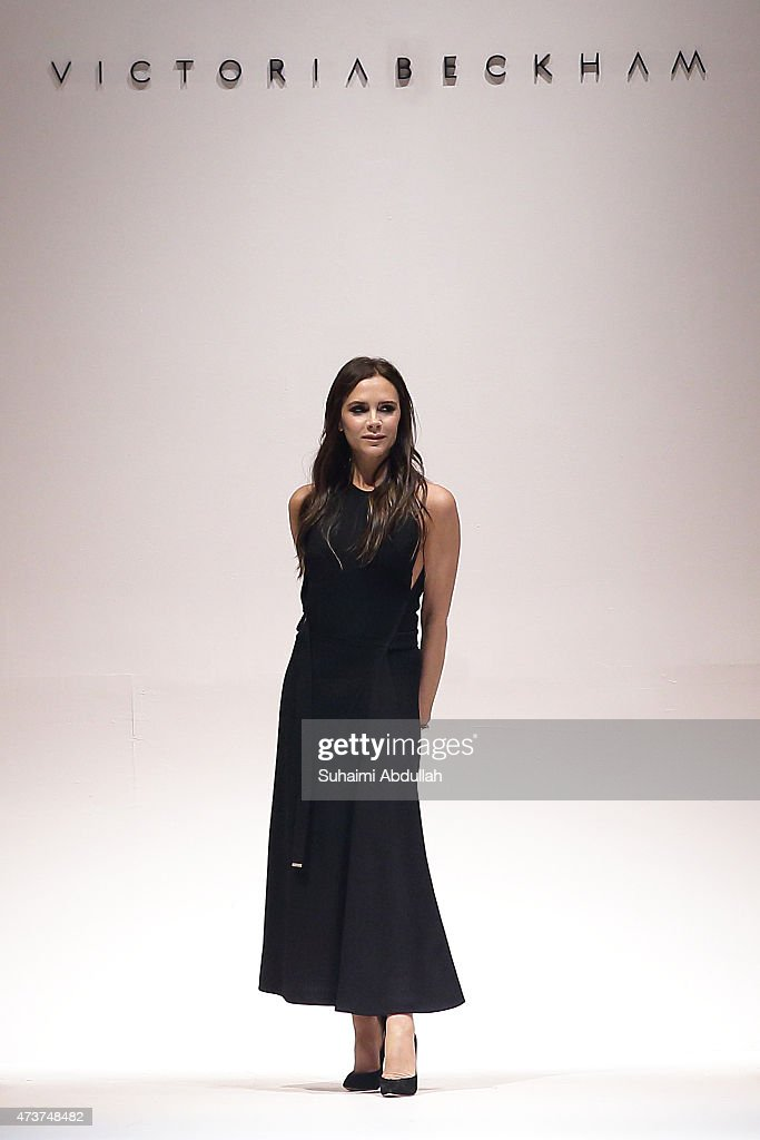 <a gi-track='captionPersonalityLinkClicked' href=/galleries/search?phrase=Victoria+Beckham&family=editorial&specificpeople=161100 ng-click='$event.stopPropagation()'>Victoria Beckham</a> greets the audience at the end of her show during the <a gi-track='captionPersonalityLinkClicked' href=/galleries/search?phrase=Victoria+Beckham&family=editorial&specificpeople=161100 ng-click='$event.stopPropagation()'>Victoria Beckham</a> Autumn/Winter 2015 collection show at Singapore Fashion Week 2015 on May 17, 2015 in Singapore, Singapore.