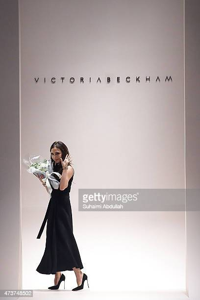 Victoria Beckham greets the audience at the end of her show during the Victoria Beckham Autumn/Winter 2015 collection show at Singapore Fashion Week...