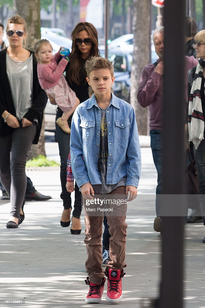 Victoria Beckham, Harper Seven Beckham and Romeo James Beckham are seen arriving at the 'Matignon' restaurant on April 21, 2013 in Paris, France.