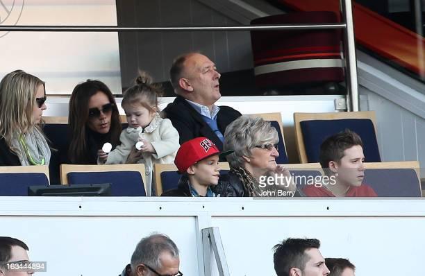 Victoria Beckham holding her daughter Harper Beckham Ted Beckham David's father below Romeo Beckham Sandra Beckham David's mother and Brooklyn...