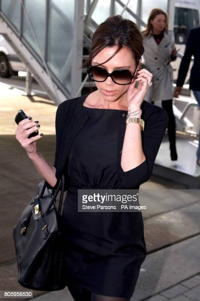 Victoria Beckham lands at Heathrow Airport in Middlesex before boarding a private plane believed to be flying to Finland where her husband David...