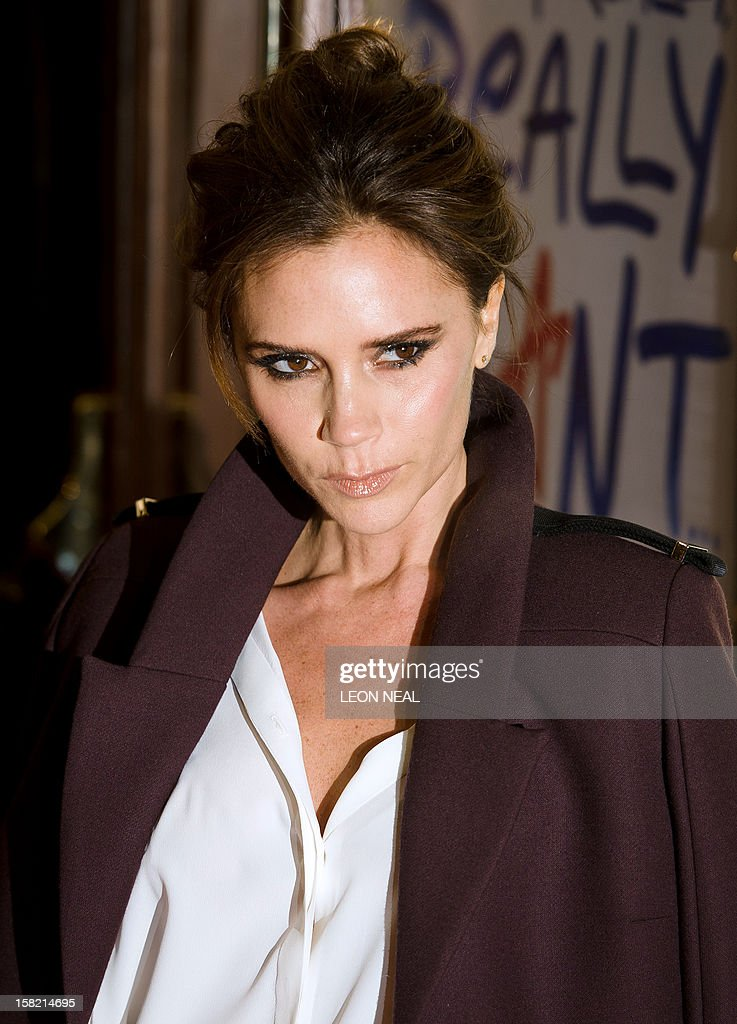 Victoria Beckham, member of the British pop girl group Spice Girls, poses for pictures on the red carpet as she arrives for the premiere of the Spice Girls musical 'Viva Forever' in central London on December 11, 2012. Viva Forever is produced by Judy Craymer, written by Jennifer Saunders and features the music of the Spice Girls. AFP PHOTO/Leon Neal
