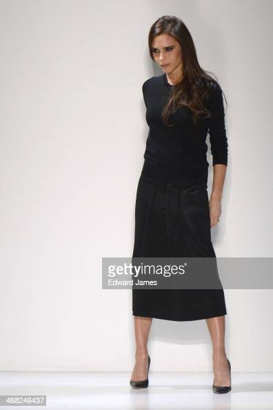 Victoria Beckham poses at the Victoria Beckham show during MercedesBenz Fashion Week Fall 2014 at Cafe Rouge on February 9 2014 in New York City