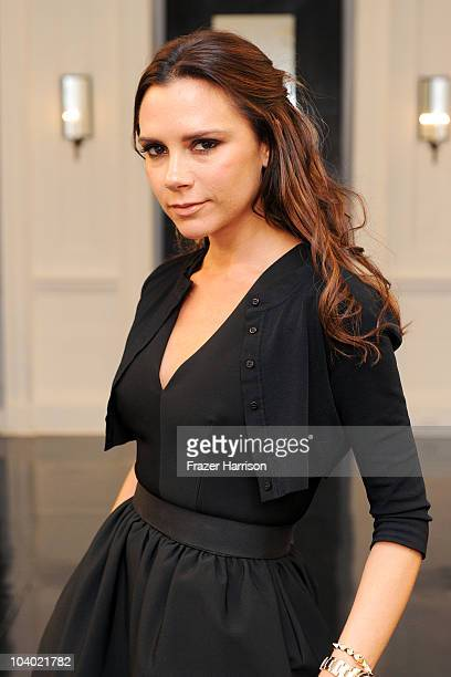 Victoria Beckham poses backstage at the Victoria Beckham Dresses Spring 2011 presentation during MercedesBenz Fashion Week at on September 12 2010 in...