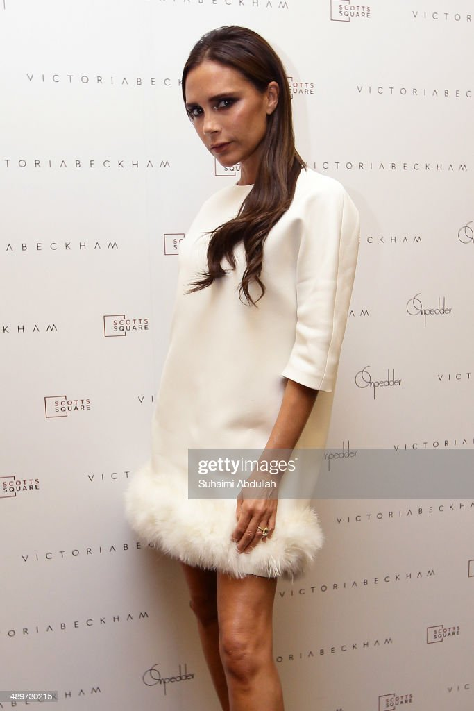 Victoria Beckham poses for a photo at On Pedder at Scotts Square on May 12 2014 in Singapore Victoria Beckham is in Singapore for the first time to...