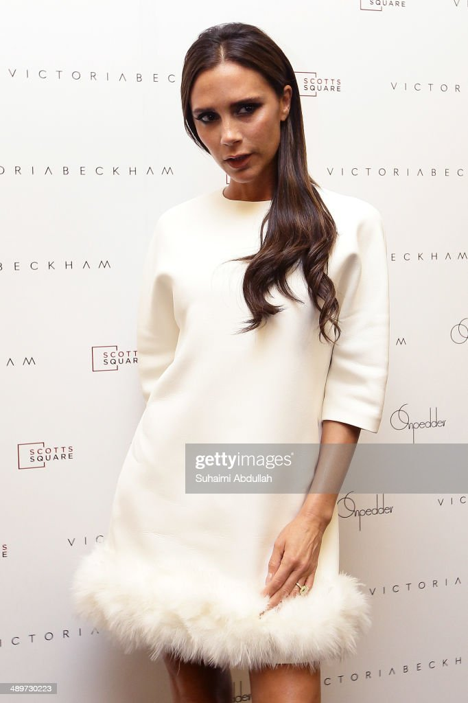 <a gi-track='captionPersonalityLinkClicked' href=/galleries/search?phrase=Victoria+Beckham&family=editorial&specificpeople=161100 ng-click='$event.stopPropagation()'>Victoria Beckham</a> poses for a photo at On Pedder at Scotts Square on May 12, 2014 in Singapore. <a gi-track='captionPersonalityLinkClicked' href=/galleries/search?phrase=Victoria+Beckham&family=editorial&specificpeople=161100 ng-click='$event.stopPropagation()'>Victoria Beckham</a> is in Singapore for the first time to showcase her ready-to-wear pieces from her eponymous fashion label in Singapore