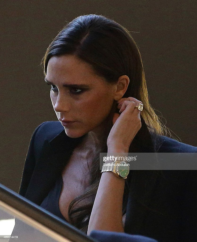 Victoria Beckham takes the escalator in The Shoppes at the Marina Bay Sands on May 11, 2014 in Singapore. Victoria Beckham is in Singapore for the first time to showcase her ready-to-wear pieces from her eponymous fashion label in Singapore