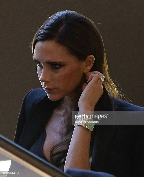 Victoria Beckham takes the escalator in The Shoppes at the Marina Bay Sands on May 11 2014 in Singapore Victoria Beckham is in Singapore for the...