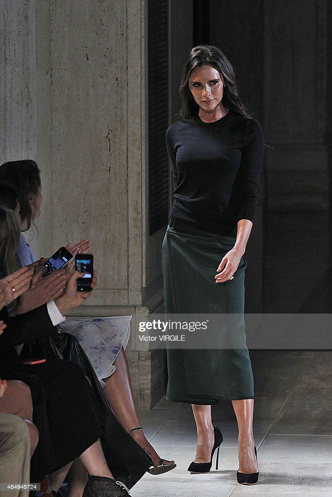 Victoria Beckham walks the runway at the Victoria Beckham fashion show during Mercedes-Benz Fashion Week Spring 2015 at The Cunard Building on September 7, 2014 in New York City.