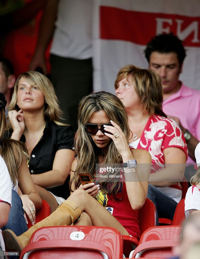 Victoria Beckham (C), wife of England Captain David Beckham, and Coleen McLoughlin (L), girlfriend of Wayne Rooney, attend the FIFA World Cup Germany 2006 Group B match between England and Trinidad and Tobago at the Frankenstadion on June 15, 2006 in Nuremberg, Germany.