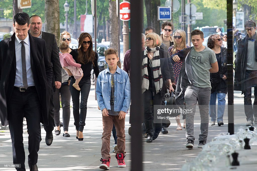 Victoria Beckham with Harper Seven Beckham, Romeo James Beckham, Jackie Adams and Cruz David Beckham are seen arriving at the 'Matignon' restaurant on April 21, 2013 in Paris, France.