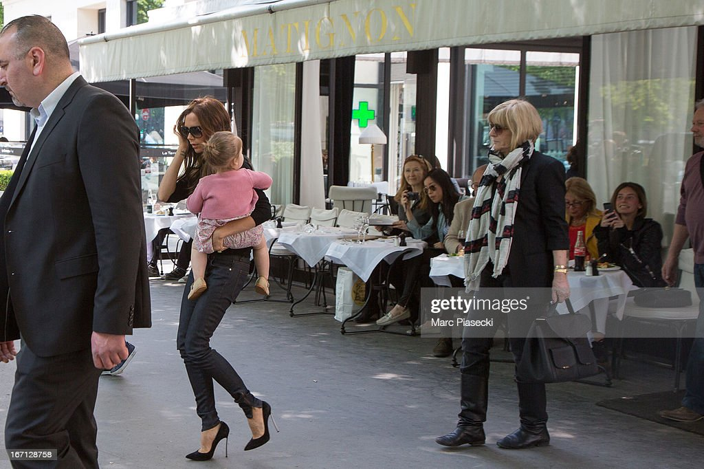 Victoria Beckham with her daughter Harper Seven Beckham and mother Jackie Adams are seen leaving the 'Matignon' restaurant on April 21, 2013 in Paris, France.