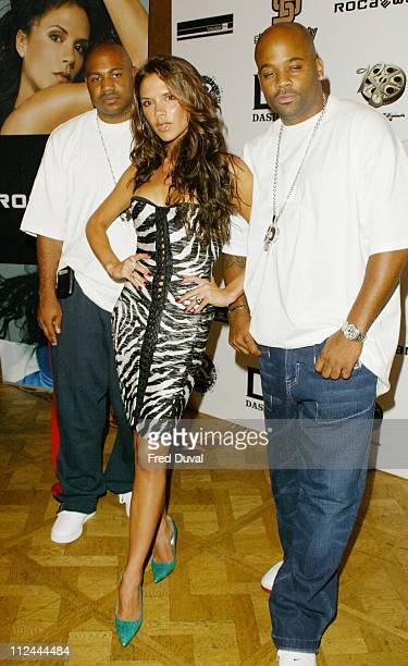 Victoria Beckham with the owners of RocaWear Kareem 'Biggs' Burke on the left and Damon Dash on the right