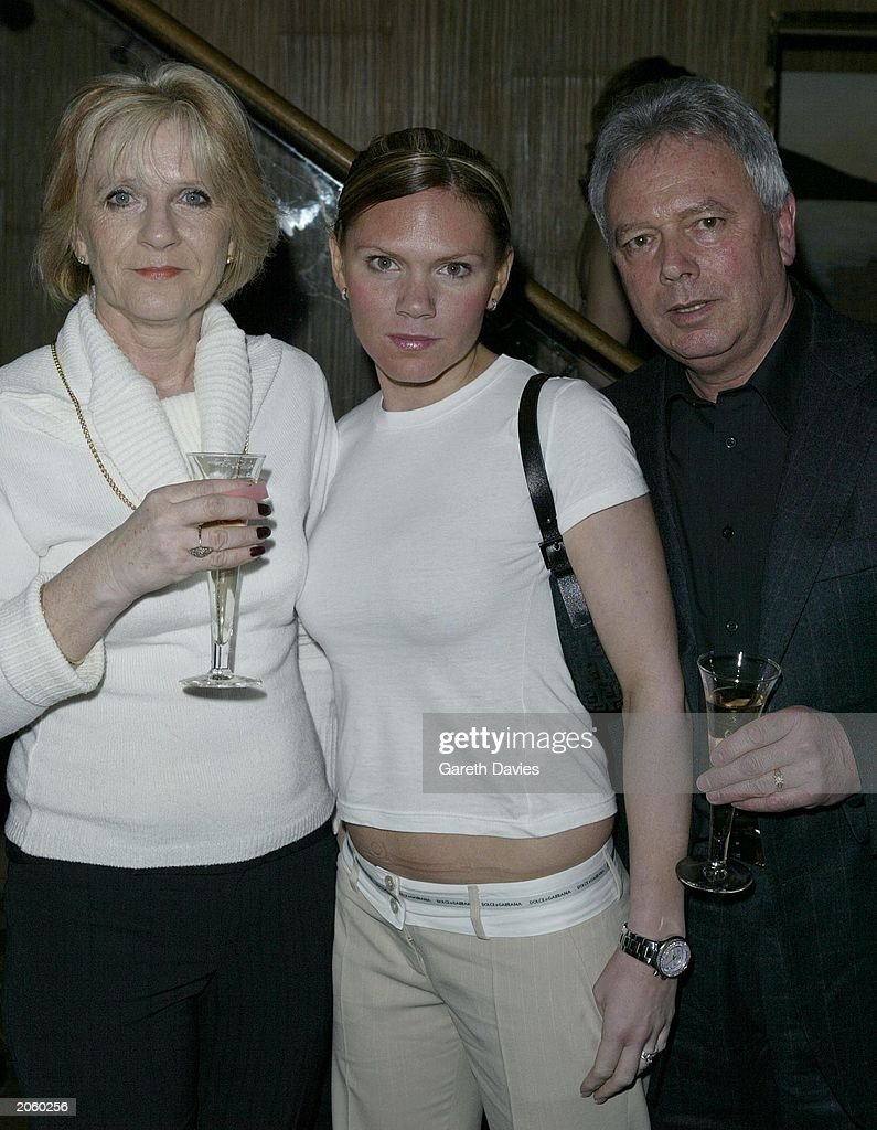 Victoria Beckham's sister Louise Adams (C) and parents Jackie and Tony at the Kyri Fashion Show at The Collection, South Kensington, London on February 19, 2003.