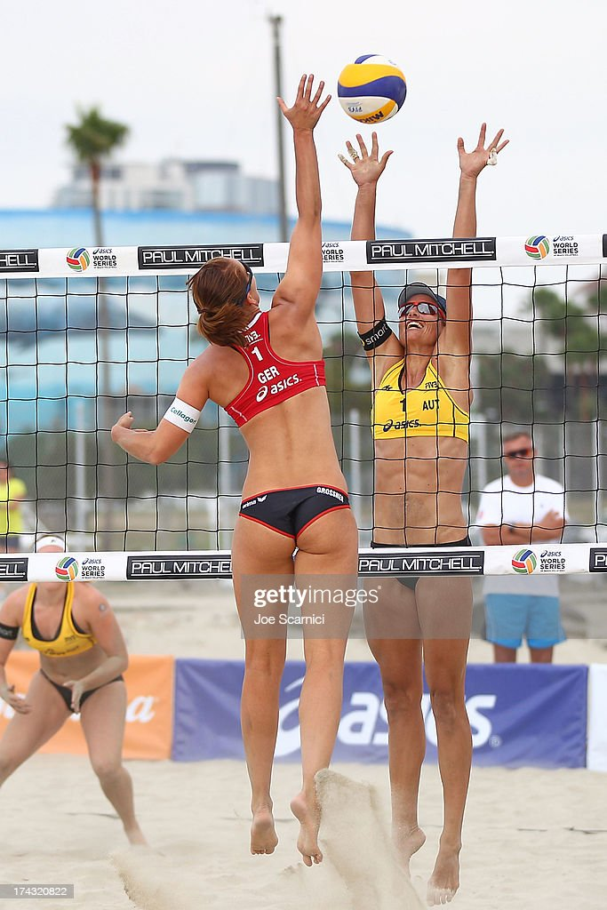 Victoria Bieneck of Germany spikes over Katharina Schutzenhofer of Austria at the ASICS World Series of Beach Volleyball - Day 2 on July 23, 2013 in Long Beach, California.