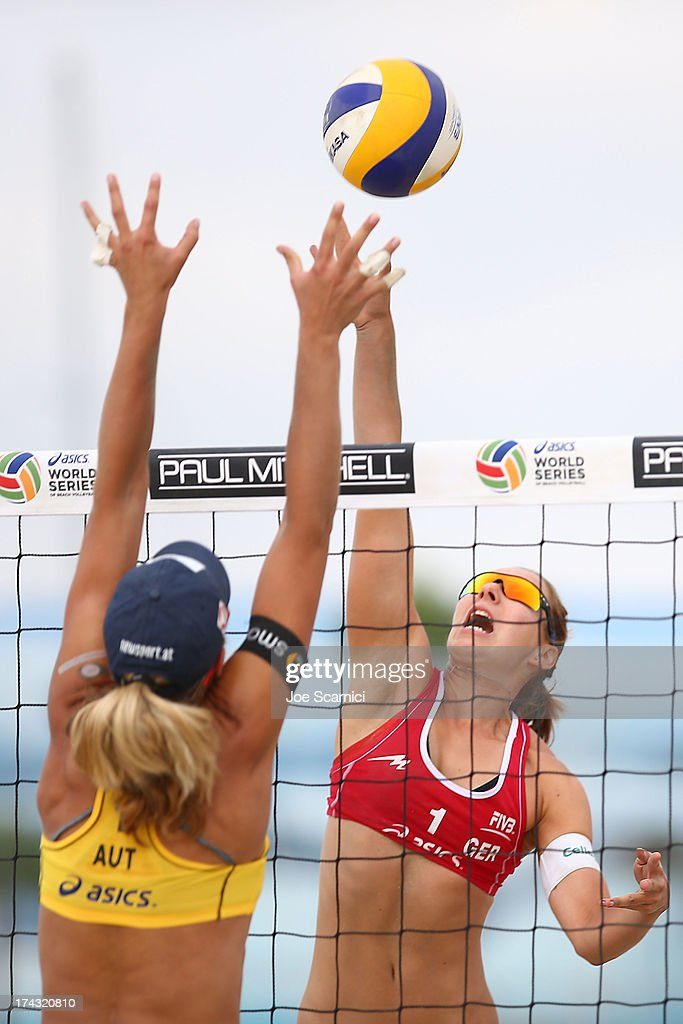 Victoria Bieneck of Germany (R) spikes the ball at the ASICS World Series of Beach Volleyball - Day 2 on July 23, 2013 in Long Beach, California.