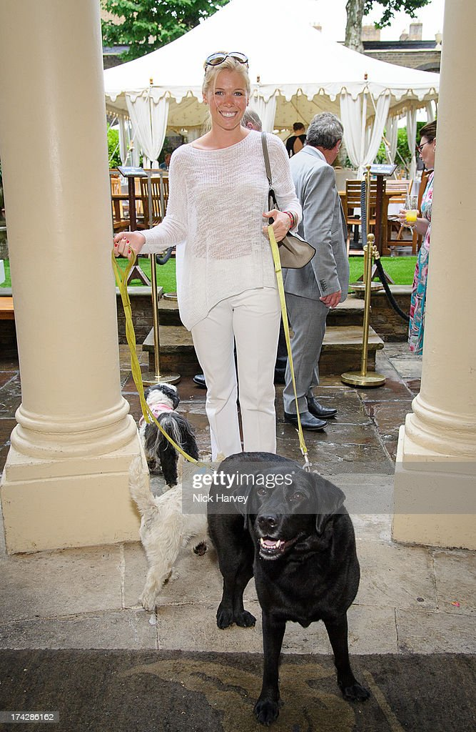 Victoria Bond-Elliott and Lucy attend the Dogs Trust Honours 2013 at Home House on July 23, 2013 in London, England.