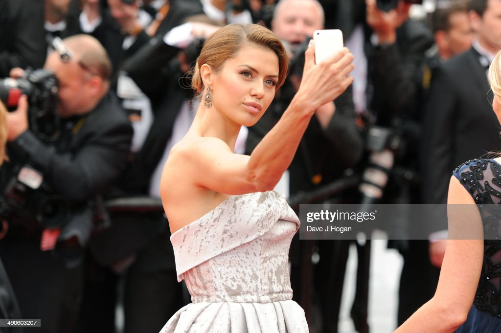 <a gi-track='captionPersonalityLinkClicked' href=/galleries/search?phrase=Victoria+Bonya&family=editorial&specificpeople=11339467 ng-click='$event.stopPropagation()'>Victoria Bonya</a> takes a selfie during the Opening ceremony and the 'Grace of Monaco' Premiere during the 67th Annual Cannes Film Festival on May 14, 2014 in Cannes, France.