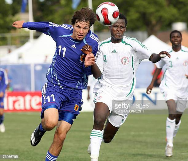 Japan's Mike Havenaar challenges Oladapo Olufemi of Nigeria during the FIFA U20 World Cup football game 07 July 2007 in Victoria British Columbia...