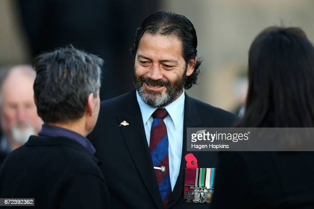 Victoria Cross winner Bill 'Willie' Apiata speaks to members of the public during Anzac Day dawn service at Pukeahu National War Memorial Park on...