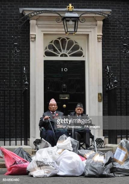 Victoria Cross winners Honorary Lieutenant Tul Bahadur Pun and Honorary Sergeant Lachiman Gurung deliver to Downing Street mailbags full of petitions...