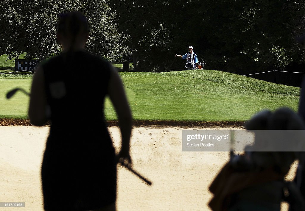Victoria Elizabeth of the United States watches Tamie Durdin of Austraila hit out of the bunker during day two of the ISPS Handa Australian Open at Royal Canberra Golf Club on February 15, 2013 in Canberra, Australia.