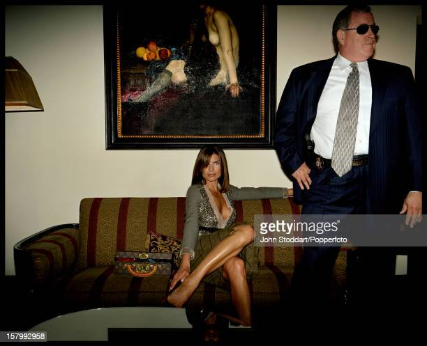 Victoria Evans ex wife of film producer Robert Evans posed with a burly bodyguard in Los Angeles in 2004