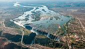 Victoria falls on helicopter. Aerial view of Victoria Falls on Zambezi River, border of Zambia and Zimbabwe. Africa