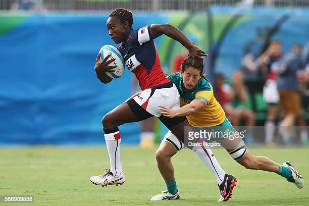 Victoria Folayan of the United States carries the ball under pressure against Emilee Cherry of Australia during the Women's Pool A rugby match on Day...