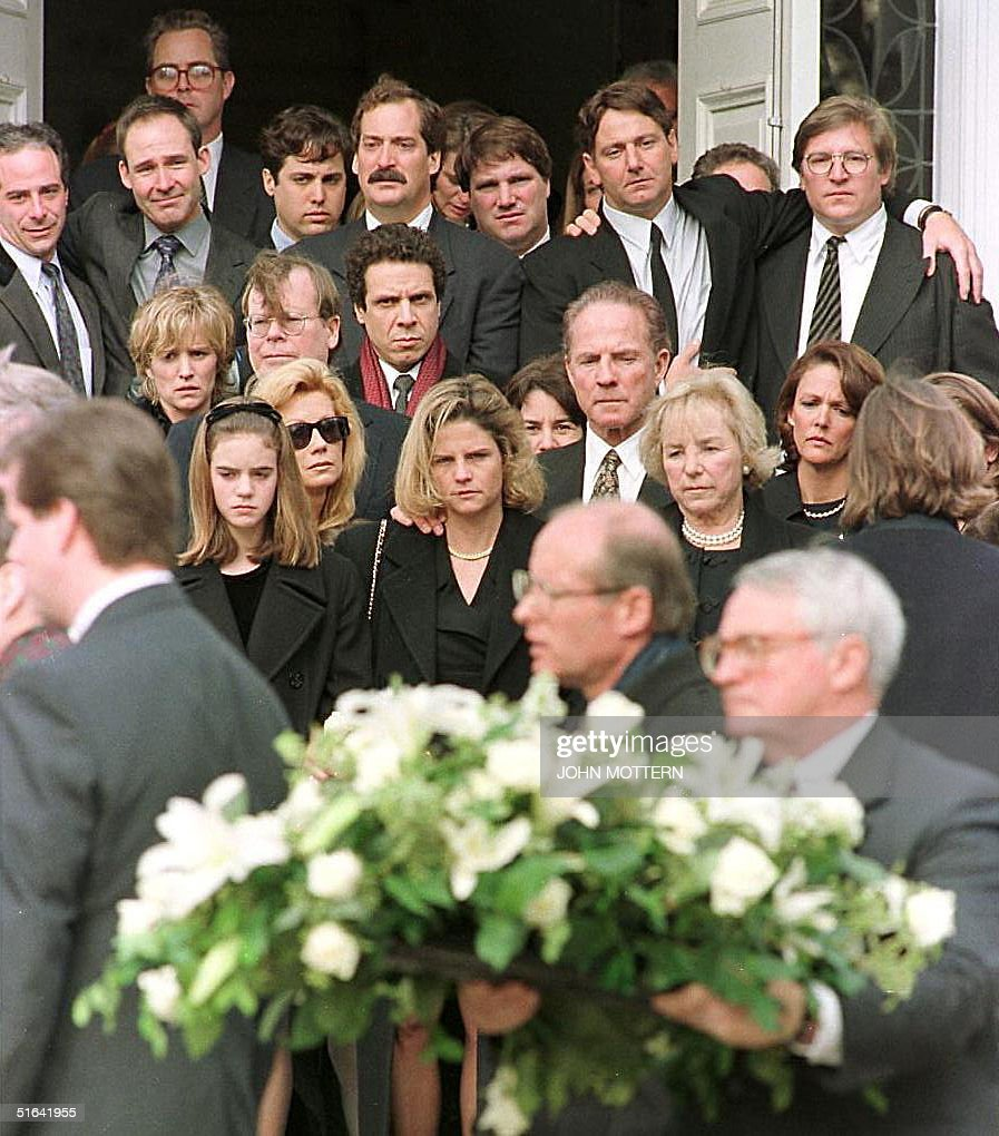 Victoria Gifford Kennedy (C), the widow of Michael Kennedy, her father Frank Gifford (center R), Michael Kennedy's mother Ethel Kennedy (3rd L, center row), Kathy Lee Gifford (center L, with sunglasses) and other family members and friends watch as the casket of Michael Kennedy is placed into the hearse at the Our Lady of Victory Parish in Centerville, MA, where funeral services were held 03 January. Michael Kennedy died in a skiing accident in Aspen, CO, 31 December. Others are unidentified.