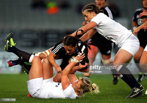 Victoria Grant of the Black Ferns is tackled by Rachael Burford of England during game one of the women's rugby series between New Zealand and...