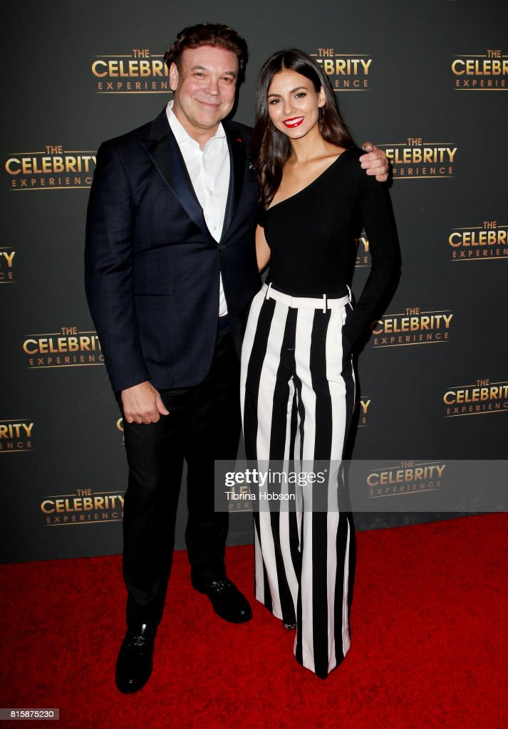 Victoria Justice (R) and George Caceres (L) attend The Celebrity Experience at Hilton Universal Hotel on July 16, 2017 in Los Angeles, California.