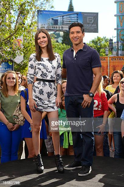 Victoria Justice and Mario Lopez visit 'Extra' at The Grove on October 26 2012 in Los Angeles California