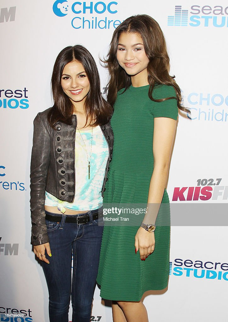 Victoria Justice (L) and Zendaya Coleman attend The Ryan Seacrest Foundation West Coast debut of new multi-media broadcast center 'Seacrest Studios' held at CHOC Children's Hospital on March 22, 2013 in Orange, California.