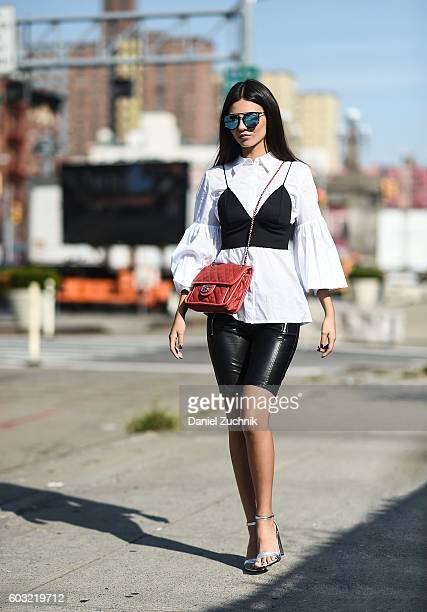 Victoria Justice is seen on the streets of Manhattan wearing a blouse bralette and shorts from HM Chanel bag Steve Madden shoes and Quay sunglasses...