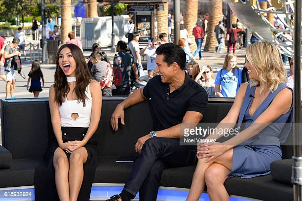 Victoria Justice Mario Lopez and Charissa Thompson visit 'Extra' at Universal Studios Hollywood on October 20 2016 in Universal City California
