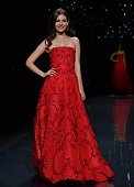 Victoria Justice presents a dress by Oscar de la Renta during The Heart Truth Red Dress Collection show sponsored by the American Heart Association...