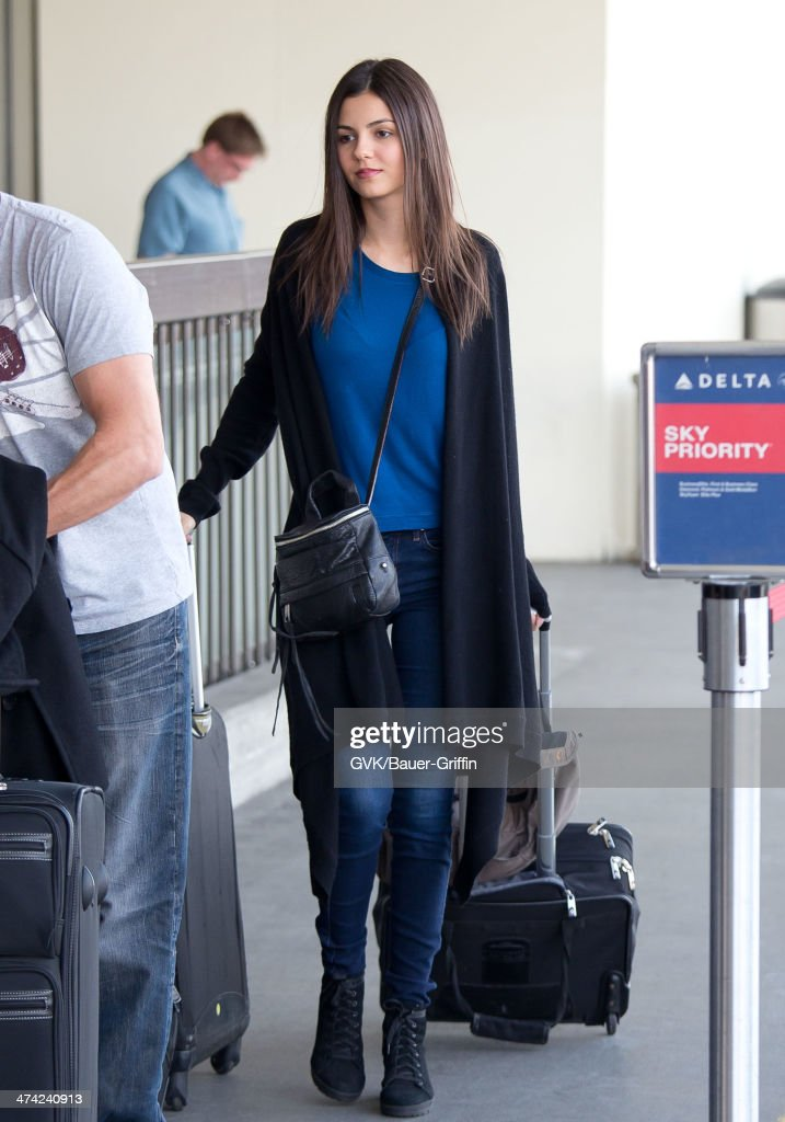 <a gi-track='captionPersonalityLinkClicked' href=/galleries/search?phrase=Victoria+Justice&family=editorial&specificpeople=569887 ng-click='$event.stopPropagation()'>Victoria Justice</a> seen at LAX airport on February 22, 2014 in Los Angeles, California.