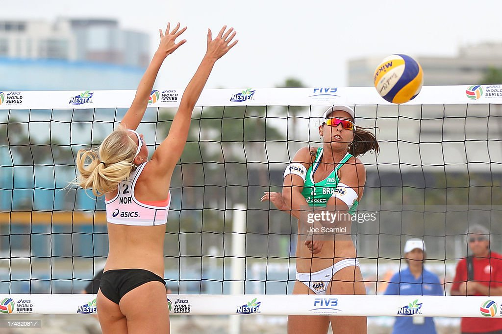 Victoria Kjolberg of Norway blocks a spike from Liliane Maestrini of Brazil at the ASICS World Series of Beach Volleyball - Day 2 on July 23, 2013 in Long Beach, California.