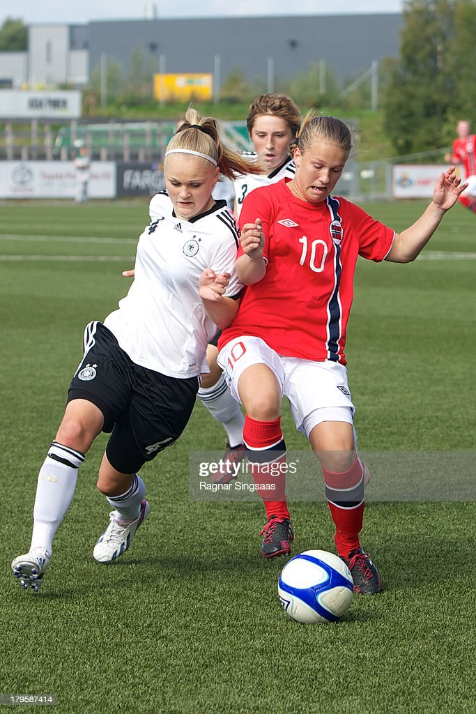 Victoria Krug of Germany (L) challenged by Synnove Hafnor of Norway during the Girls Friendly match between Norway U16 and Germany U16 at the UKI Arena on September 5, 2013 in Jessheim, Norway.