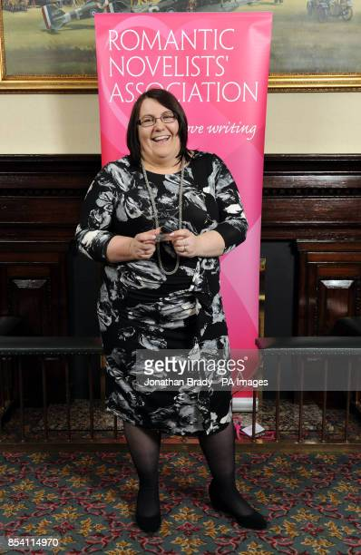 Victoria Lamb holds her award for Young Adult Romantic Novel at the Romantic Novelists' Association Awards held at the RAF Club London PRESS...