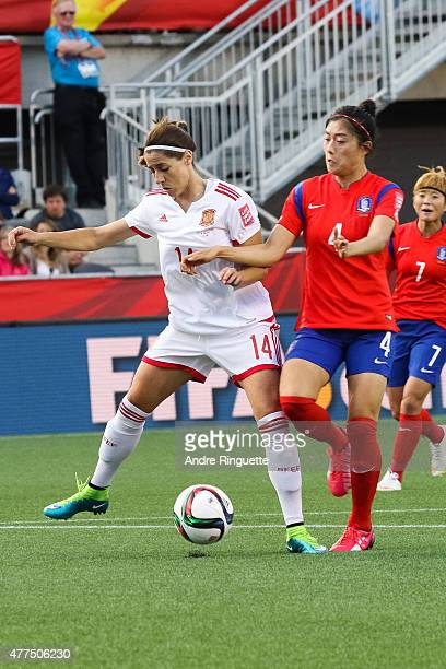 Victoria Losada of Spain battles for the ball against Seoyeon Shim of Korea Republic during the FIFA Women's World Cup Canada 2015 Group E match...