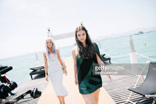 Victoria Magrath and Barabara Palvin are photographed at the L'Oreal Paris Beach during the 70th annual Cannes Film Festival on May 24 2017 in Cannes...