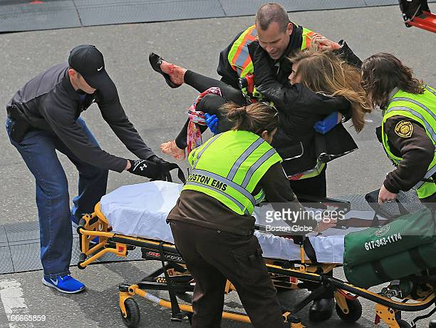 Victoria McGrath who was injured in an explosion near the finish line of the 117th Boston Marathon is taken away from the scene on a stretcher