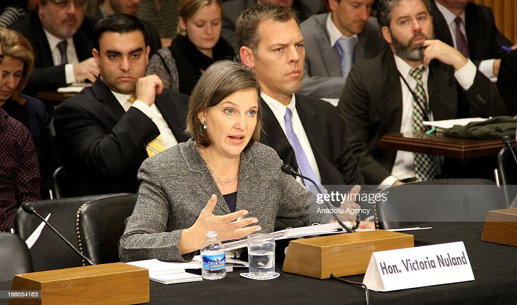 Victoria Nuland (Front), the Assistant Secretary of State for European and Eurasian Affairs at the United States Department of State answers the senators' questions on the United States Senate Foreign Relations Committee on November 14, 2013 in Washington DC, United States.