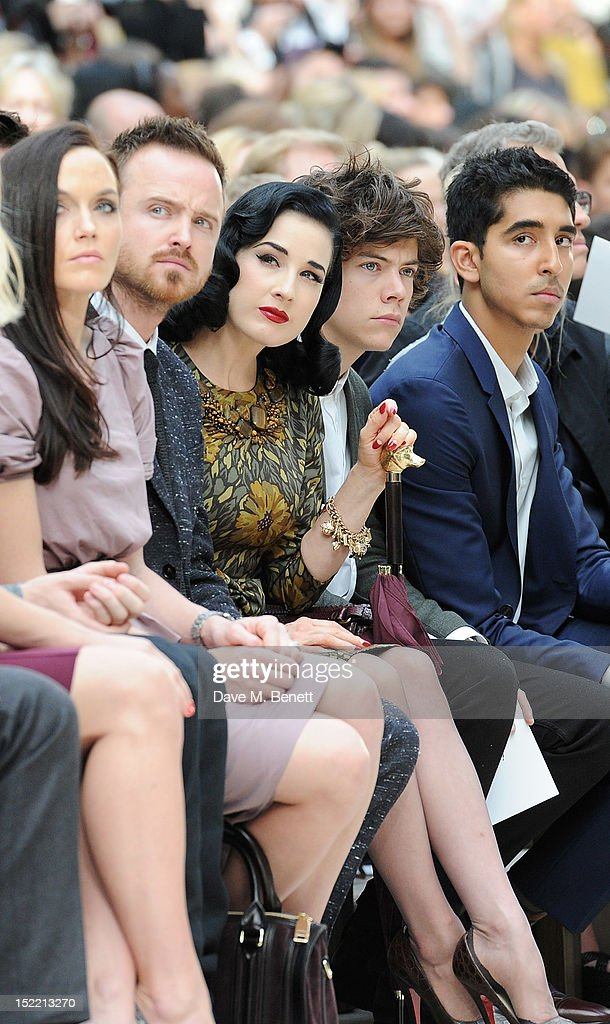Victoria Pendleton, Aaron Paul, Dita Von Teese, Harry Styles and Dev Patel attend the Burberry Spring Summer 2013 Womenswear Show Front Row at Kensington Gardens on September 17, 2012 in London, England.